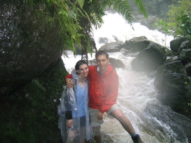 base of the falls, at the river created from heavy rain