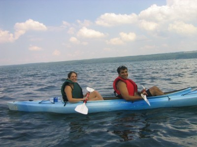 two people; one paddler