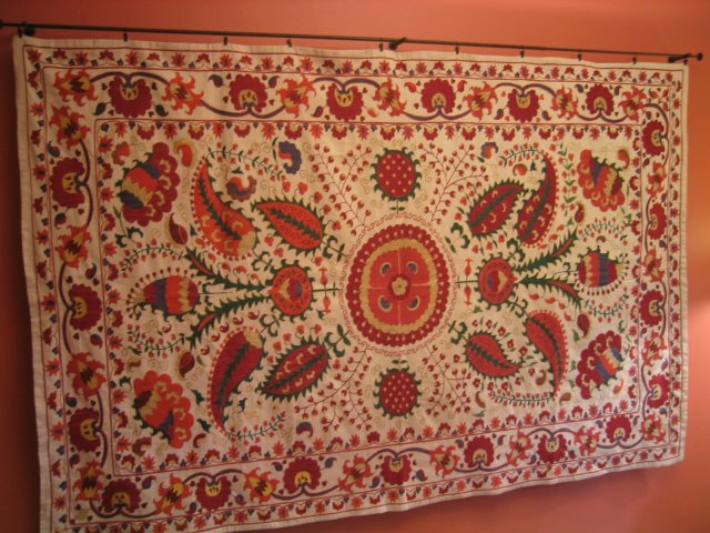 after hours of comparing prices and searching for patterns we liked, we bought this beautiful Suzani rug at Istanbul's Grand Bazaar