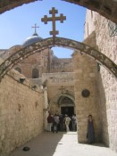 sara at one of the stations of the cross on the Via Dolorosa (#9, where Jesus fell the third time)