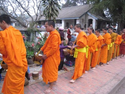 Luang Prabang, monks receiving their morning alms