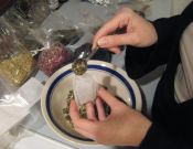 filling the tea bags with a custom blended tea