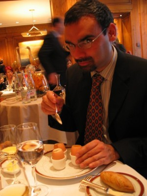 """the two things in this picture are (1) Taillevent's version of """"scrambled eggs,"""" and (2) a man who is very intent on eating them."""
