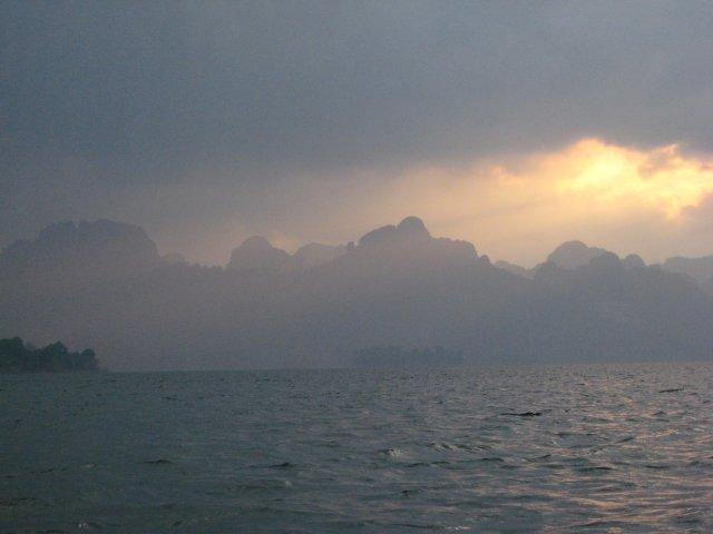a dramatic sun rise through the clouds